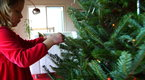 Howcast Home: How To Hang Garlands and Tinsel on a Christmas Tree